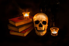Vintage Skull and Novels by Candlelight Royalty Free Stock Image