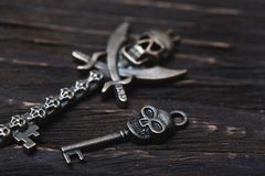 Vintage skull skeleton keys on a wooden table royalty free stock image