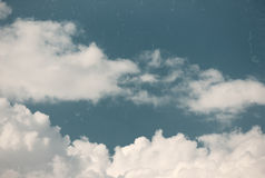 Vintage sky with fluffy clouds. Close up view of fluffy clouds brightly lit by the sun Royalty Free Stock Image