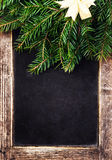 Vintage slate chalk board with Christmas Decoration. Christmas T Stock Photography