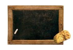Vintage slate, chalk and sponge Royalty Free Stock Images
