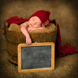 Vintage slate and newborn baby Stock Images