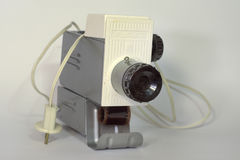 Vintage slide projector loaded with film. Front view on lens royalty free stock photography