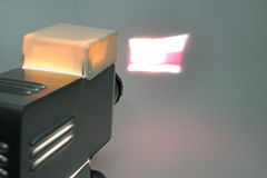 Vintage slide projector in work. Back view royalty free stock photos
