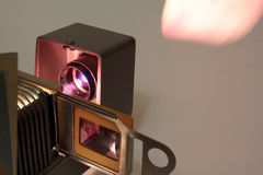 Vintage slide projector. Working in a dark room Royalty Free Stock Photography
