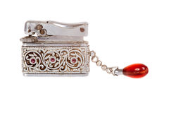 Vintage sliver lighter with red jewel Royalty Free Stock Photos
