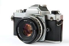 Vintage SLR camera. Vintage SLR film camera isolated Stock Images