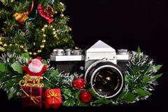 Vintage slr photo camera and merry Christmas stock image