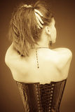 Vintage slyle lady in corset stock images