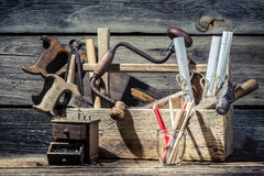Vintage small carpentry workshop. On old wooden table Royalty Free Stock Photos