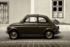 Free Vintage Small Italian Made Car In Side View. Grunge Stucco Elevation Background Stock Photo - 219368670