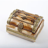 Vintage small ornate treasure box made of camel bone. Beautiful vintage small ornate treasure box made of camel bone with metal decor. Square image royalty free stock photo