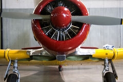 Vintage Small Red and Yellow Propeller Airplane Stock Images