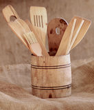 Vintage small wooden bucket with various kitchen utensils Royalty Free Stock Photo