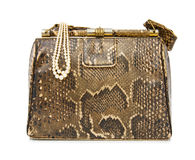 Vintage snakeskin bag. Fake snakeskin bag from the '50s. Isolated over white background. This image is exclusive to Dreamstime Stock Images