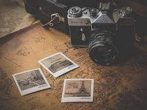 Vintage snapshots on map Royalty Free Stock Photos