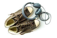 Vintage sneakers and headphones. Royalty Free Stock Photo