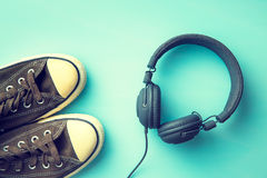 Vintage sneakers and headphones. Royalty Free Stock Image