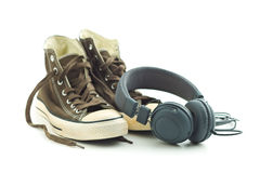 Vintage sneakers and headphones. Stock Photography