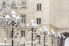 Vintage snow covered  street lamps in a row Royalty Free Stock Image