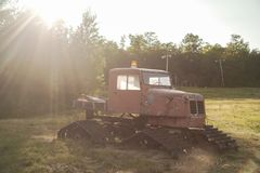Vintage Snow Groomer in Summer. On a sunny day creating solar flares and appealing light royalty free stock images
