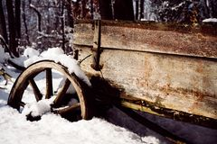 Vintage snow wagon. Aged wood royalty free stock images