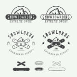 Vintage snowboarding logos, badges, emblems and design elements. Royalty Free Stock Photos