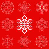 Vintage snowflake set in zentangle style. 25 original vector sno. W flakes  on red background, for Christmas, New Year decoration. Hand drawn doodle objects Royalty Free Stock Photography