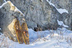 Vintage snowshoes and rocks Royalty Free Stock Image