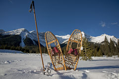 Vintage snowshoes and ski poles Royalty Free Stock Photos