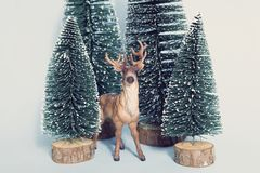 Vintage snowy forest firs and reindeer Royalty Free Stock Images