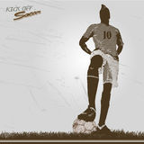 Vintage soccer player kick off. Soccer player vintage style on grass ready to kick off Royalty Free Stock Photo