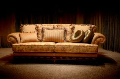 Vintage sofa. Stylish vintage sofa with pillows Royalty Free Stock Photography