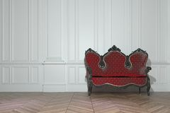 Vintage sofa in a classic paneled room Royalty Free Stock Photos