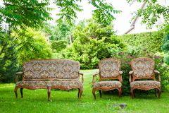 Vintage sofa on the grass. Outside Stock Images