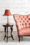 Vintage sofa and lamp on white wall. Pink vintage sofa and lamp on white wall Royalty Free Stock Image
