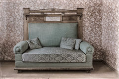 Vintage sofa in the old house Stock Photography
