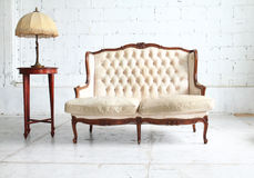 Vintage sofa in the room Royalty Free Stock Images