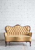 Vintage sofa on white wall. Stock Image