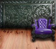 Vintage sofa with wooden wall Stock Images