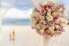 Romantic decoration with flowers of a beach wedding on the beach with sea in the background stock image