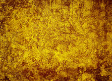 Vintage soiled grunge yellowy-brown background Stock Image
