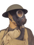 Vintage soldier wearing gasmask isolated. Upper body and head of a World War One soldier wearing a gasmask and helmet.  Isolated on white Stock Photography