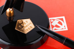 Vintage soviet fountain pen with stand on red folder with ussr symbols Stock Images