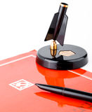 Vintage soviet fountain pen with stand and red folder with ussr symbols Stock Photo