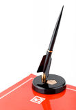 Vintage soviet fountain pen on stand and red folder with ussr symbols Stock Photography