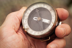 Vintage Soviet military compass in hand stock images