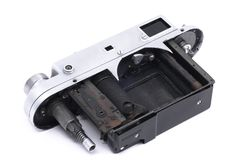 Vintage soviet rangefinder camera taken apart. Isolated on white Royalty Free Stock Image