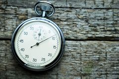 Vintage soviet stopwatch on the wooden boards royalty free stock photography