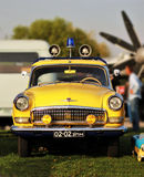 Vintage soviet yellow police car GAZ with flashing light at the Old Car Land Festival Royalty Free Stock Photography